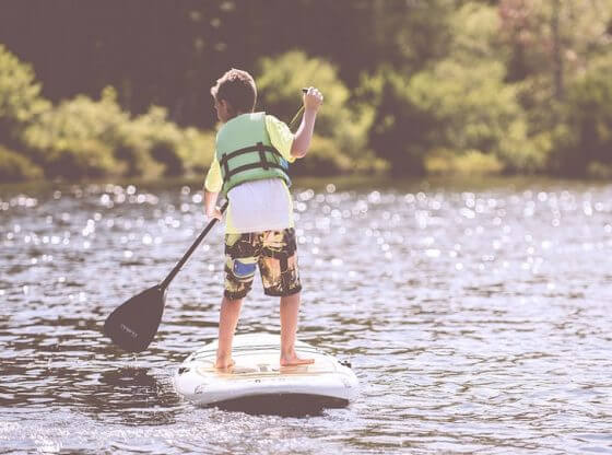 up the river with a paddle.